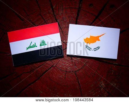 Iraqi Flag With Cypriot Flag On A Tree Stump Isolated