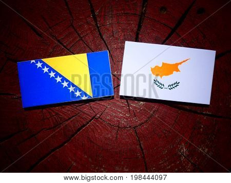 Bosnia And Herzegovina Flag With Cypriot Flag On A Tree Stump Isolated
