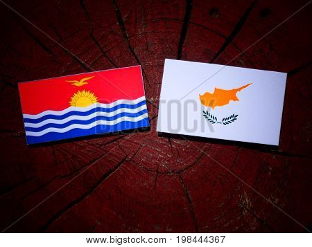 Kiribati Flag With Cypriot Flag On A Tree Stump Isolated