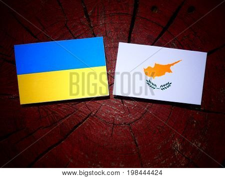 Ukrainian Flag With Cypriot Flag On A Tree Stump Isolated