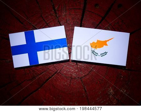 Finnish Flag With Cypriot Flag On A Tree Stump Isolated