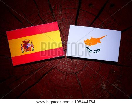 Spanish Flag With Cypriot Flag On A Tree Stump Isolated