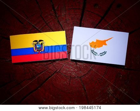 Ecuador Flag With Cypriot Flag On A Tree Stump Isolated