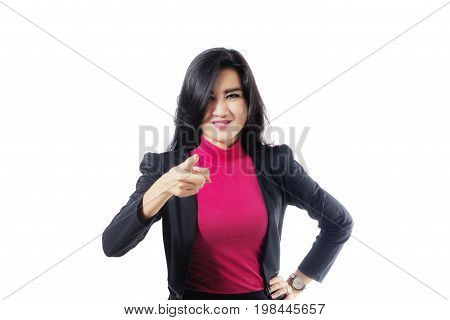 Photo of a beautiful female entrepreneur looks angry while pointing at the camera isolated on white background