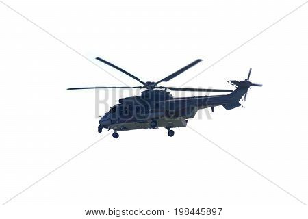 Image of army helicopter hovering in the studio isolated on white background