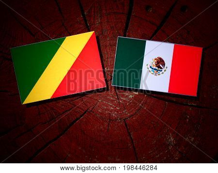 Republic Of The Congo Flag With Mexican Flag On A Tree Stump Isolated
