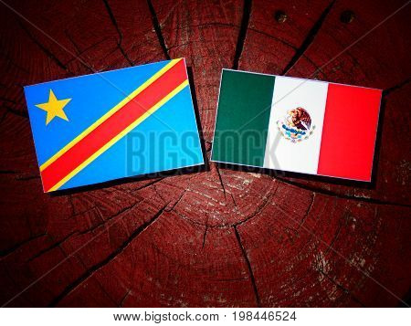 Democratic Republic Of The Congo Flag With Mexican Flag On A Tree Stump Isolated