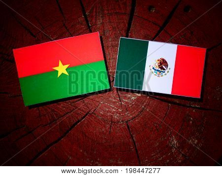 Burkina Faso Flag With Mexican Flag On A Tree Stump Isolated