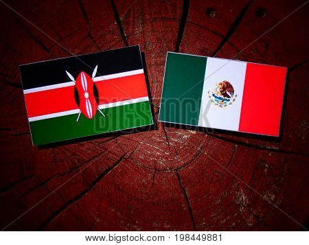 Kenyan Flag With Mexican Flag On A Tree Stump Isolated