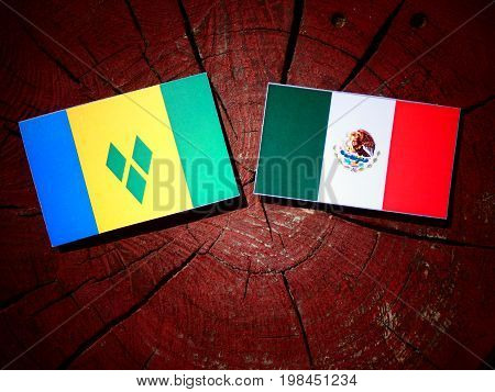 Saint Vincent And The Grenadines Flag With Mexican Flag On A Tree Stump Isolated