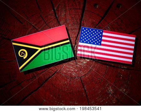 Vanuatu Flag With Usa Flag On A Tree Stump Isolated