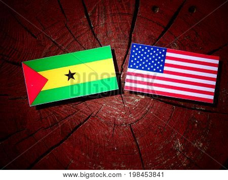 Sao Tome And Principe Flag With Usa Flag On A Tree Stump Isolated