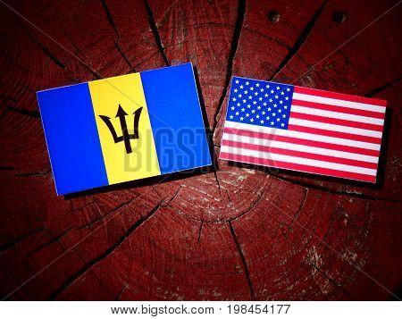 Barbados Flag With Usa Flag On A Tree Stump Isolated