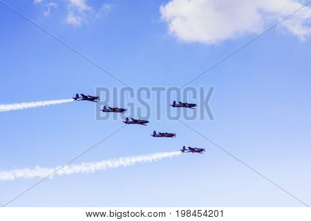 Image of jet army plane flying and making formation in the blue sky