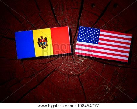 Moldovan Flag With Usa Flag On A Tree Stump Isolated