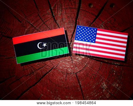Libyan Flag With Usa Flag On A Tree Stump Isolated