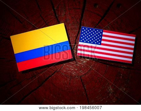 Colombian Flag With Usa Flag On A Tree Stump Isolated