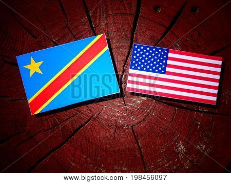 Democratic Republic Of The Congo Flag With Usa Flag On A Tree Stump Isolated