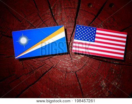 Marshall Islands Flag With Usa Flag On A Tree Stump Isolated