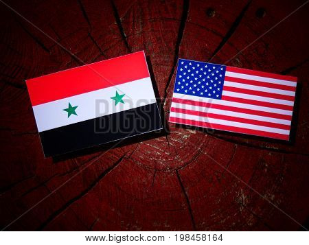 Syrian Flag With Usa Flag On A Tree Stump Isolated