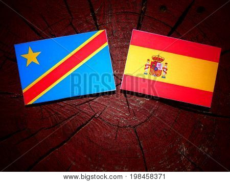 Democratic Republic Of The Congo Flag With Spanish Flag On A Tree Stump Isolated
