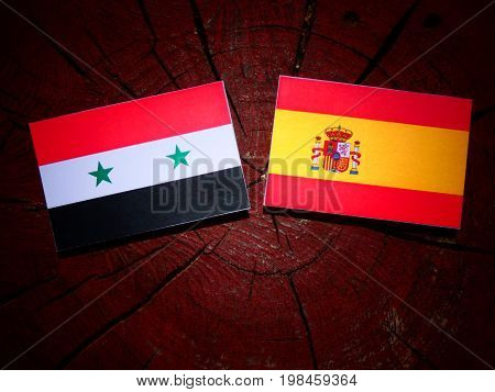 Syrian Flag With Spanish Flag On A Tree Stump Isolated
