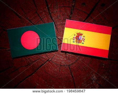 Bangladesh Flag With Spanish Flag On A Tree Stump Isolated