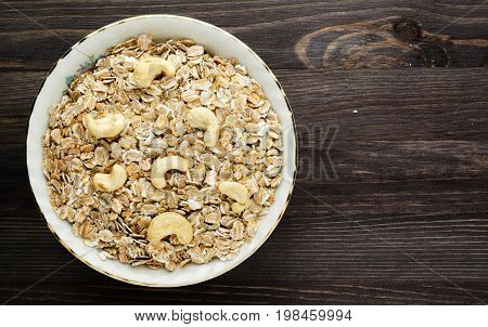 Oatmeal With Nuts Cashews. Oatmeal On A Wooden Table. Oatmeal Top View. Healthy Food