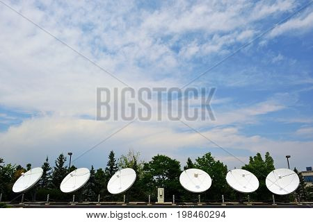 Six Large Satellite Dishes on a Sunny Day