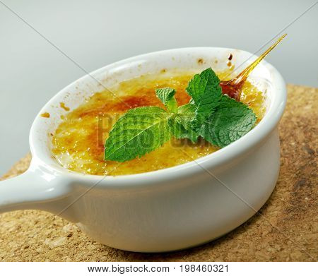 Creme brulee with mint cooked close up