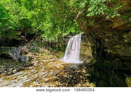 stunning amazing inviting view of Ontario, Niagara escarpment, Halton Hills water fall in woods on sunny summer day