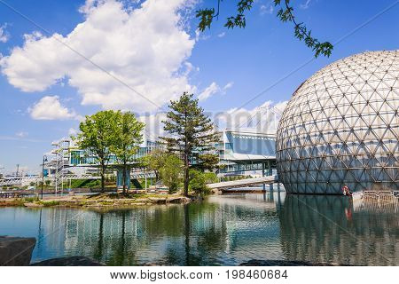 Toronto, Ontario, Canada, June 16, 2017 nice amazing, inviting view of Toronto Ontario Place park grounds with stylish cinesphere in water and other structures background