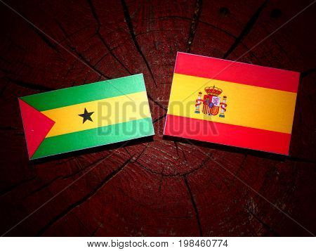 Sao Tome And Principe Flag With Spanish Flag On A Tree Stump Isolated