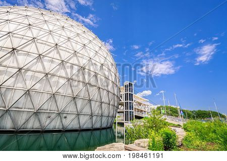 Toronto, Ontario, Canada, June 16, 2017 nice amazing, inviting view of Toronto Ontario Place park grounds, stylish inviting cinesphere with buildings in background on summer sunny day