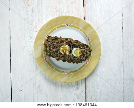 Drob - traditional Romanian dish similar to a haggis made of minced lamb's offal wrapped in caul and roasted like a meatloaf