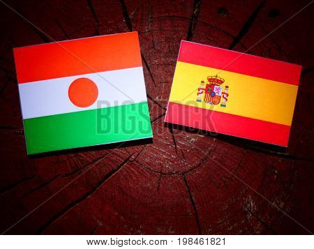 Niger Flag With Spanish Flag On A Tree Stump Isolated