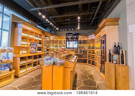 Toronto, Ontario, Canada,  wine store, June 16, 2017, great, nice closeup view of various wine on wooden shelf's inside cozy wine store in Toronto down town area
