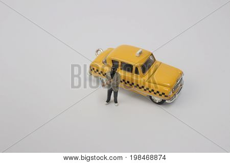 Thief Man Miniature Figure With Taxi