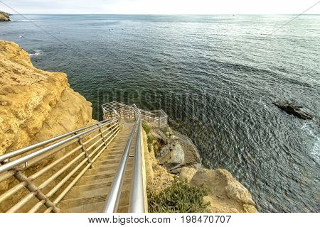 Stairs Down To The Ocean In Point Loma, California With Horizon