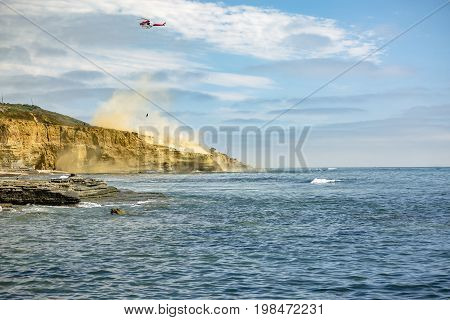 Us Coastguard Helicopter In Flight, Point Loma Beach With Dust