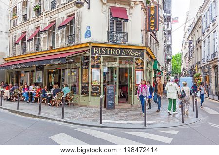 PARIS, FRANCE - JUNE 8, 2012: Le Bistro St. Andrew located in the 6th arrondissement of Paris, in a lively district close to the Saint-Michel fountain.