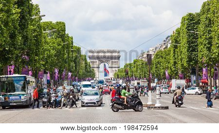 PARIS, FRANCE - JUNE 8, 2012: The Avenue des Champs-Elysees, the most famous avenue in the world, stretches for two kilometres from the Place de la Concorde to the Place Charles de Gaulle the site of the Arc de Triomphe in Paris.