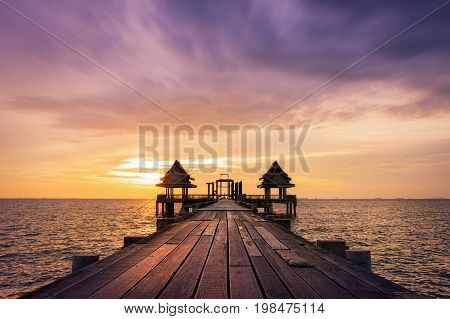 Twilight wood bridge at Djittabhawan Temple tourist attraction in PattayaThailand