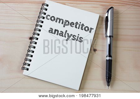 Competitor analysis on white paper book and office supplies on wood desk / business concept