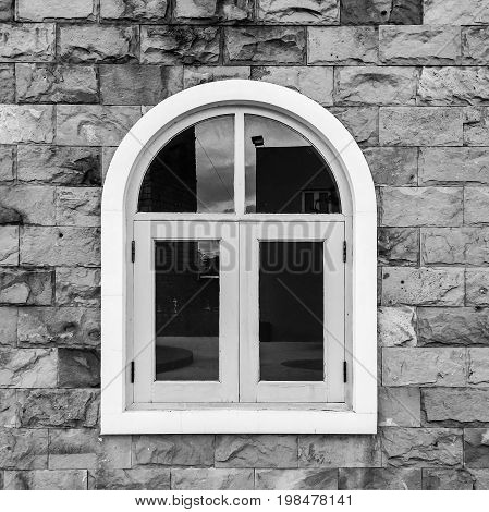 European style window with brick wall background