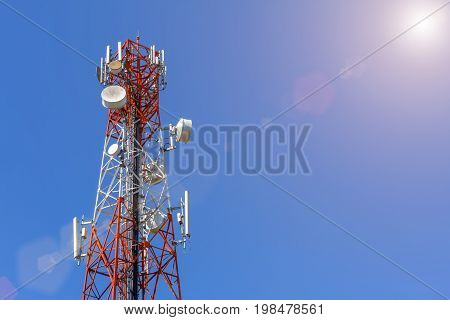 Telecommunication Cellular or Radio antenna tower in blue sky with sunshine background for Industrial energy power network technology digital data transport and communication concept idea design.