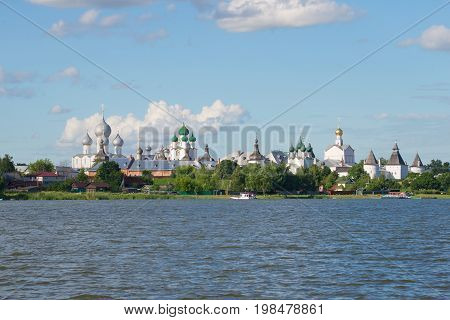 ROSTOV VELIKY, RUSSIA - JULY 19, 2017: A view of domes of ancient temples of Rostov Veliky from the lake Nero. Golden Ring of Russia