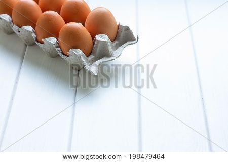 Eggs in the paper tray package on white background.