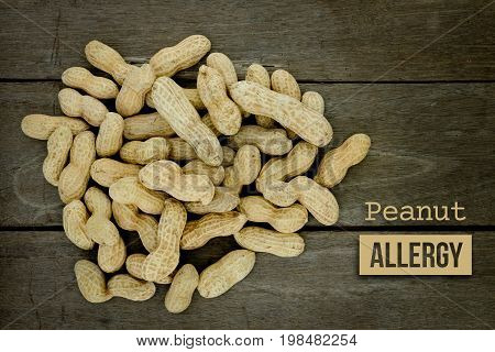 Peanut Or Groundnut Food Allergy Health Concept, Close Up On Wooden Background