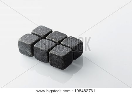 Set of six spirit chilling stones. Soapstone rocks are carved in cubes to be used as drink chiller (whisky bourbon ...) Various type of raw minerals produces different colors such as charcoal black.